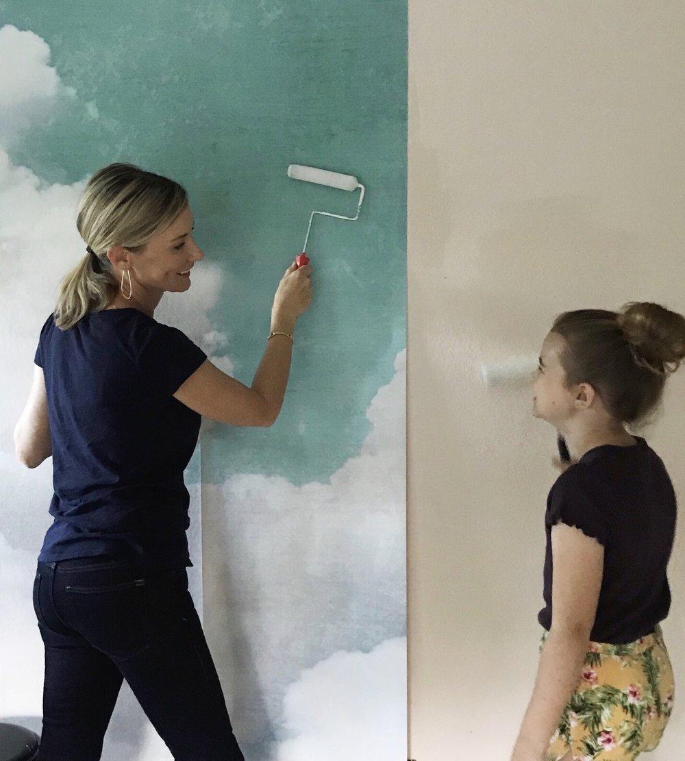 installing wall mural.jpg