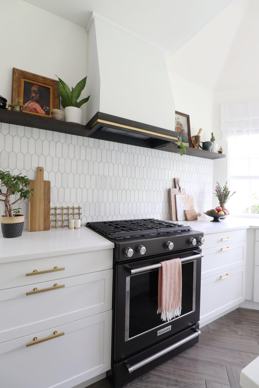 kitchen custom hood with brass detail .jpg