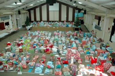 Hundreds of presents donated to 1,100 children in the Gift of Hope program fill The Fathers House church on Thursday. (Barbara Arrigoni/Staff Photo)