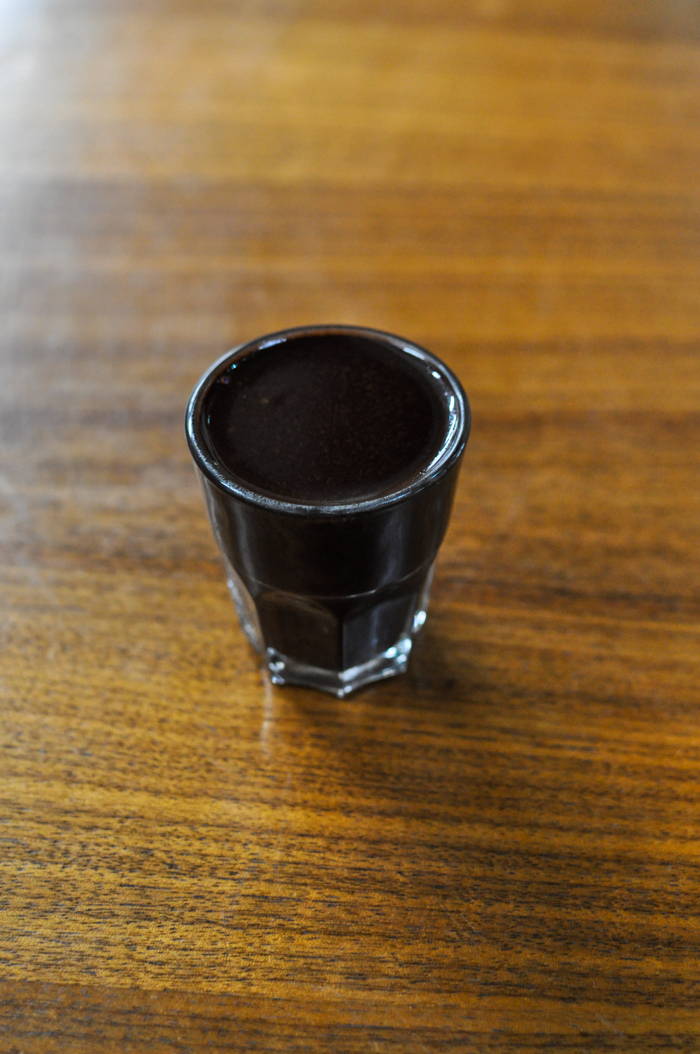 A shot glass full of melted chocolate. This is what dreams are made of.