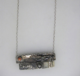 Sterling and fine silver with pink coral  $ 200