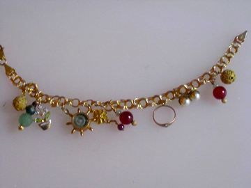 14kt gold with opals, carnelian, amazonite, $3000.00