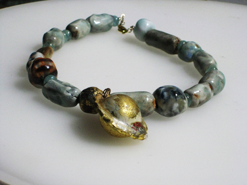 Porcelain,aquamarine and 22kt gold leaf with gold filled clasp  $195.00