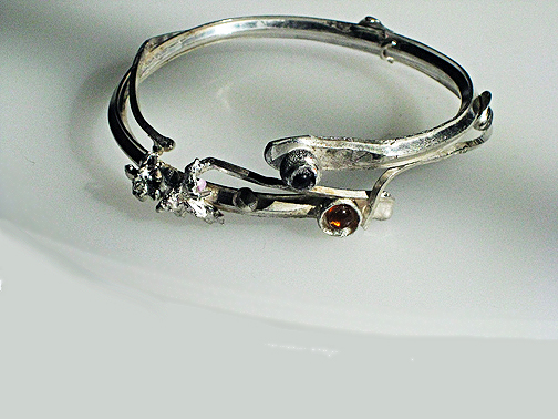 Bramble bangle with three stones $185