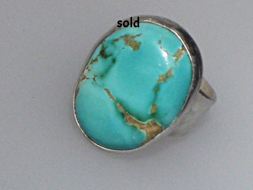 Turquoise planet ring  $ 385.00