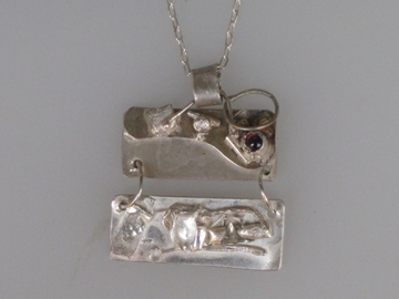 Sterling and fine silver with garnet  $225