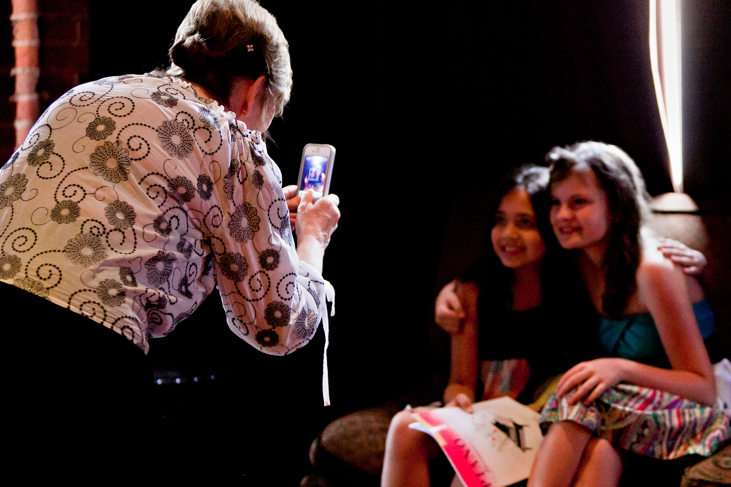 A grandma taking picture of her granddaughters after performing at House of Blues Dallas.