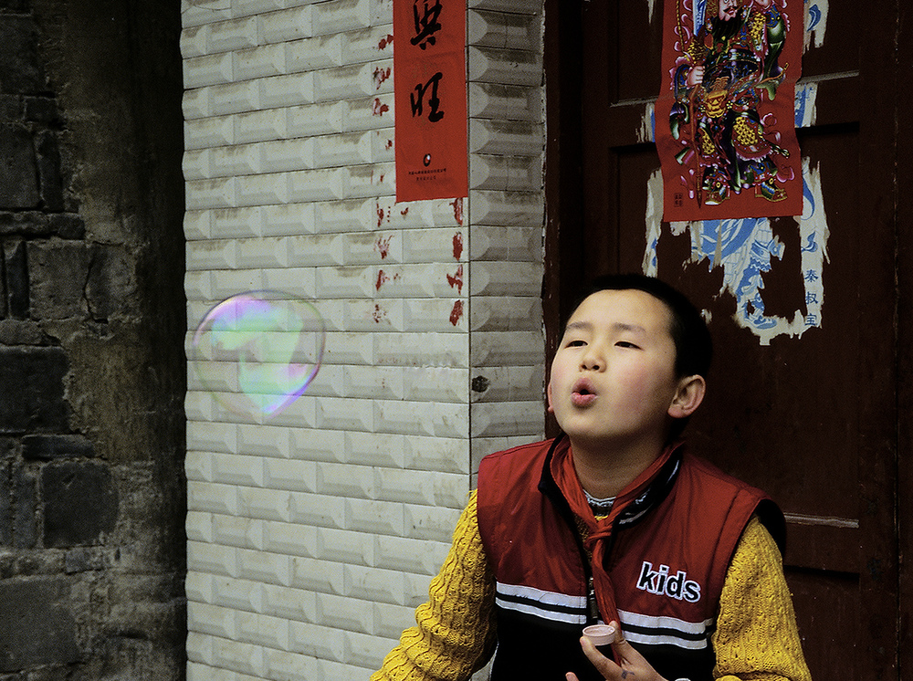 Blowing bubbles, China