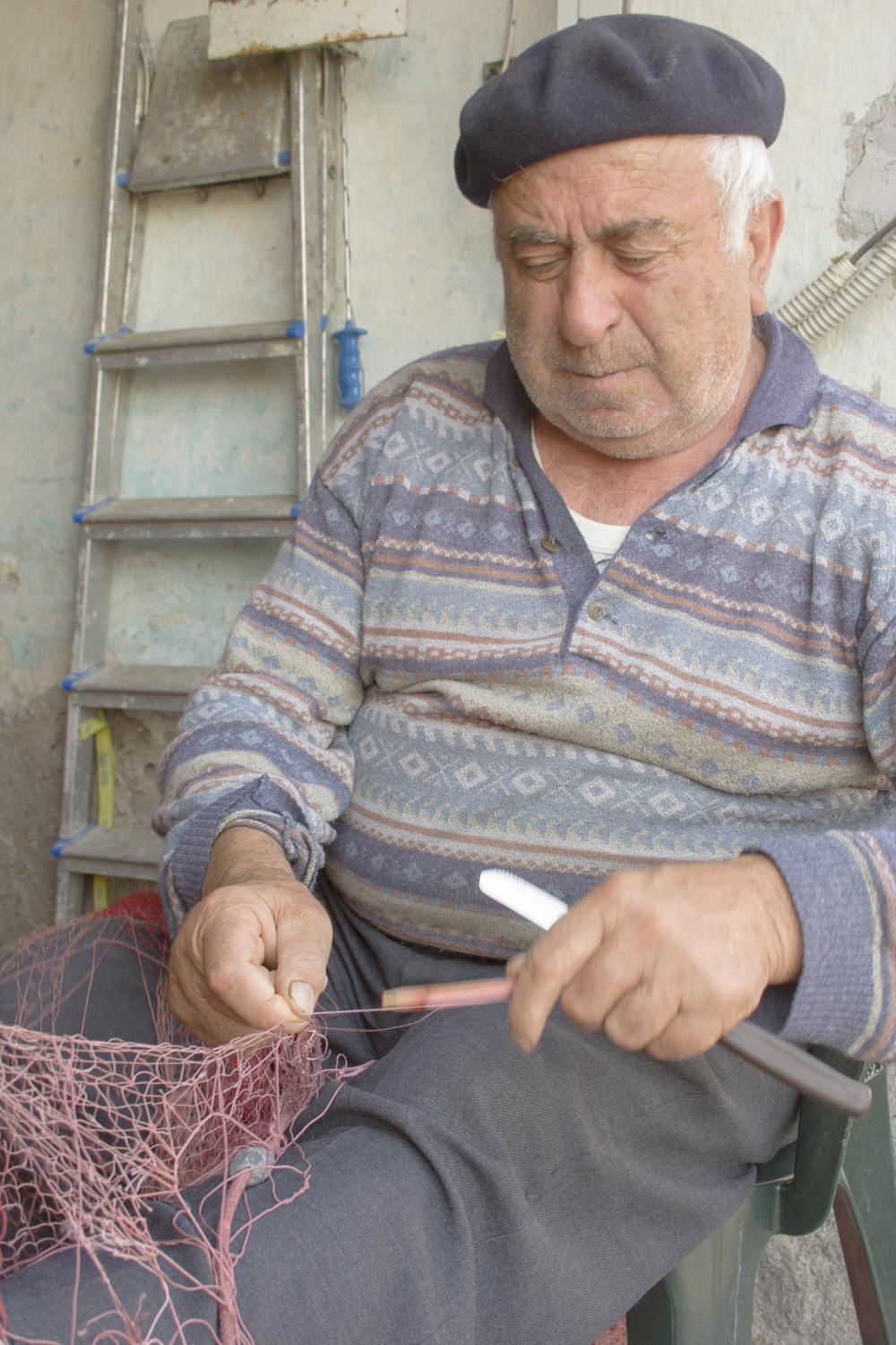 Fisherman mending nets, Sicily