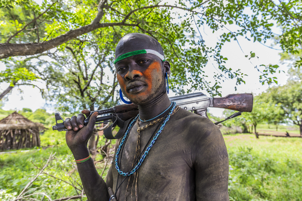 Mursi man, Omo Valley