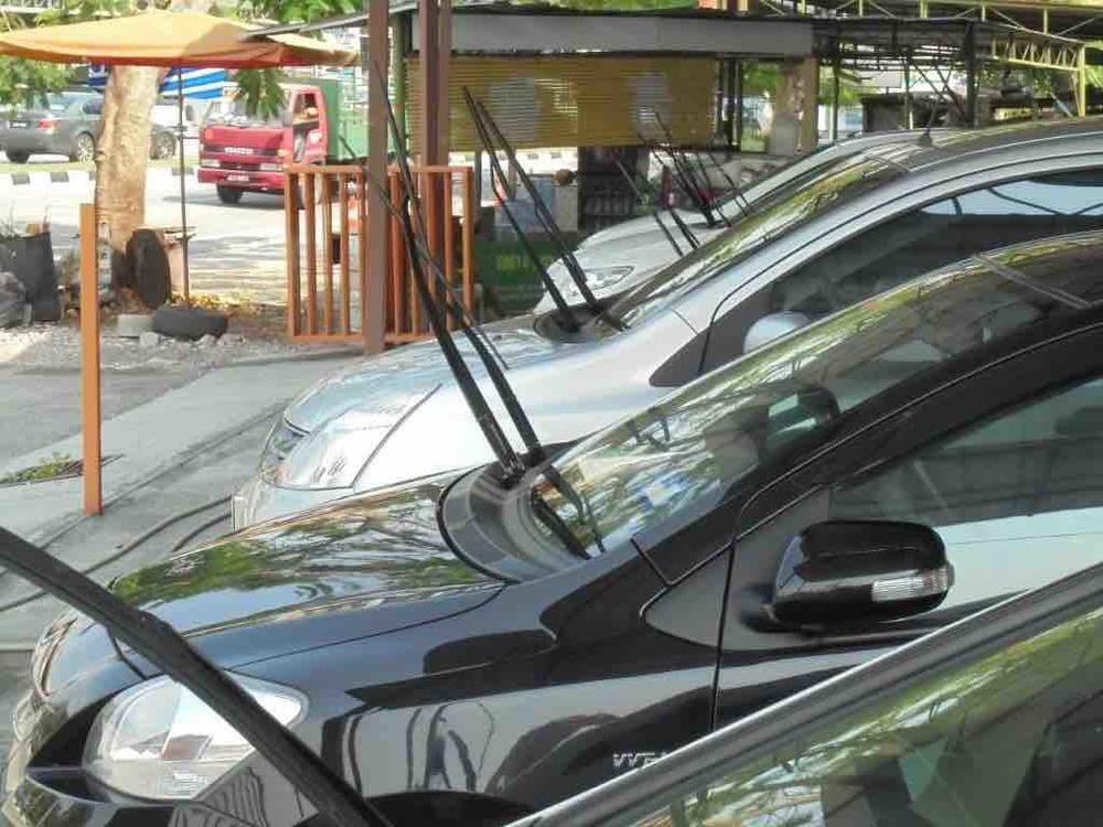 Windscreen wipers in car sales yards