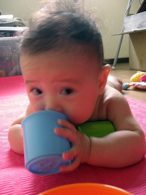 Hi mama (sheepishly sucking cup)