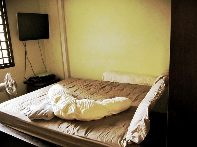 This is the bed which is against the 'walk-in' wardrobe.