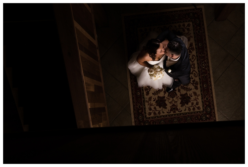 We found a cozy little spot in the staircase for a steamy shot of Erin and Roy.