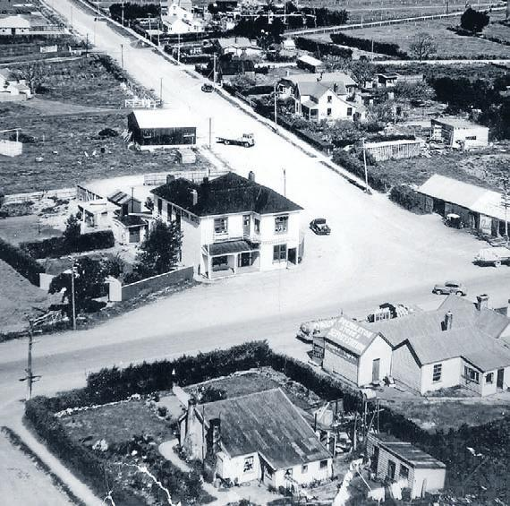Aerial view:    Prebbleton circa 1950, showing   the hotel corner and Station Road (now   Tosswill) stretching into the distance.