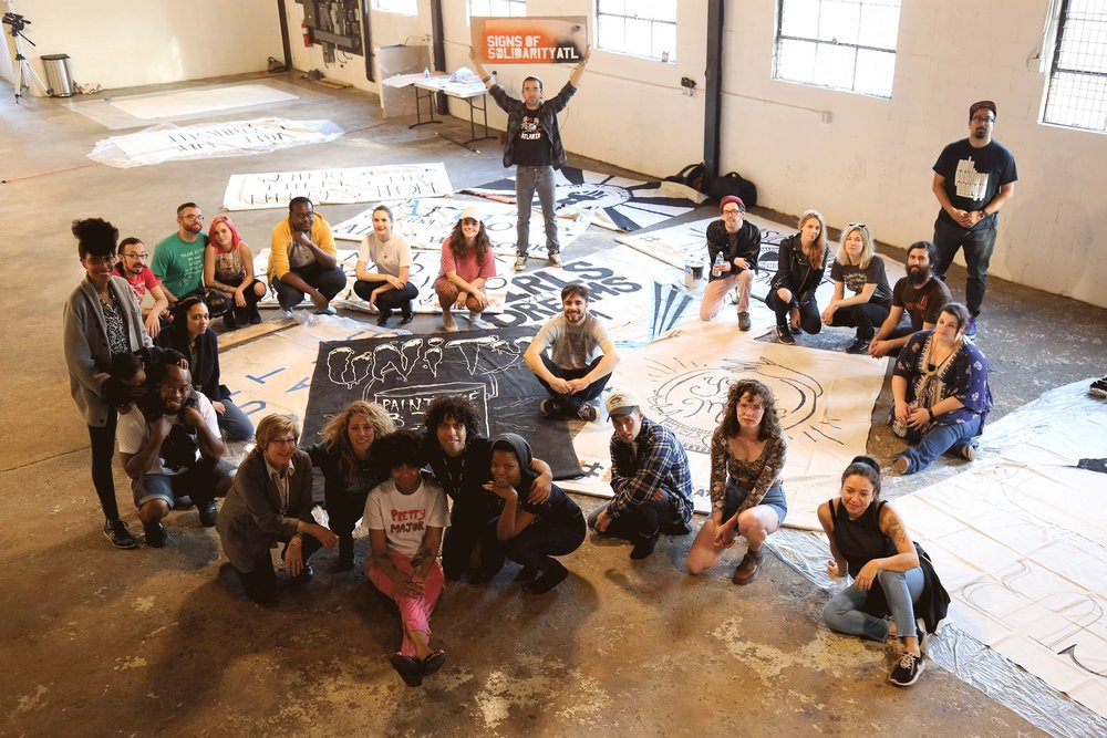See all Signs of Solidarity, created by 30 ATL artists, on display this week.
