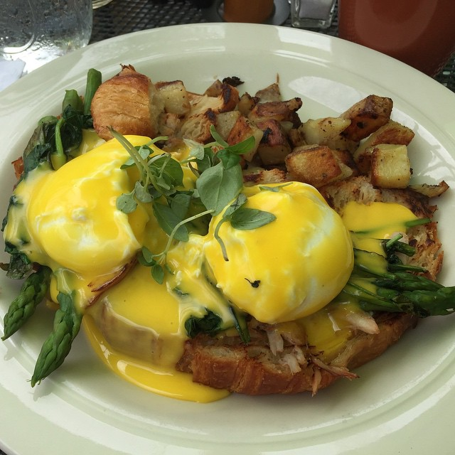 Breakfast food junkie feat. crab, asparagus, and spinach eggs benedict on a croissant