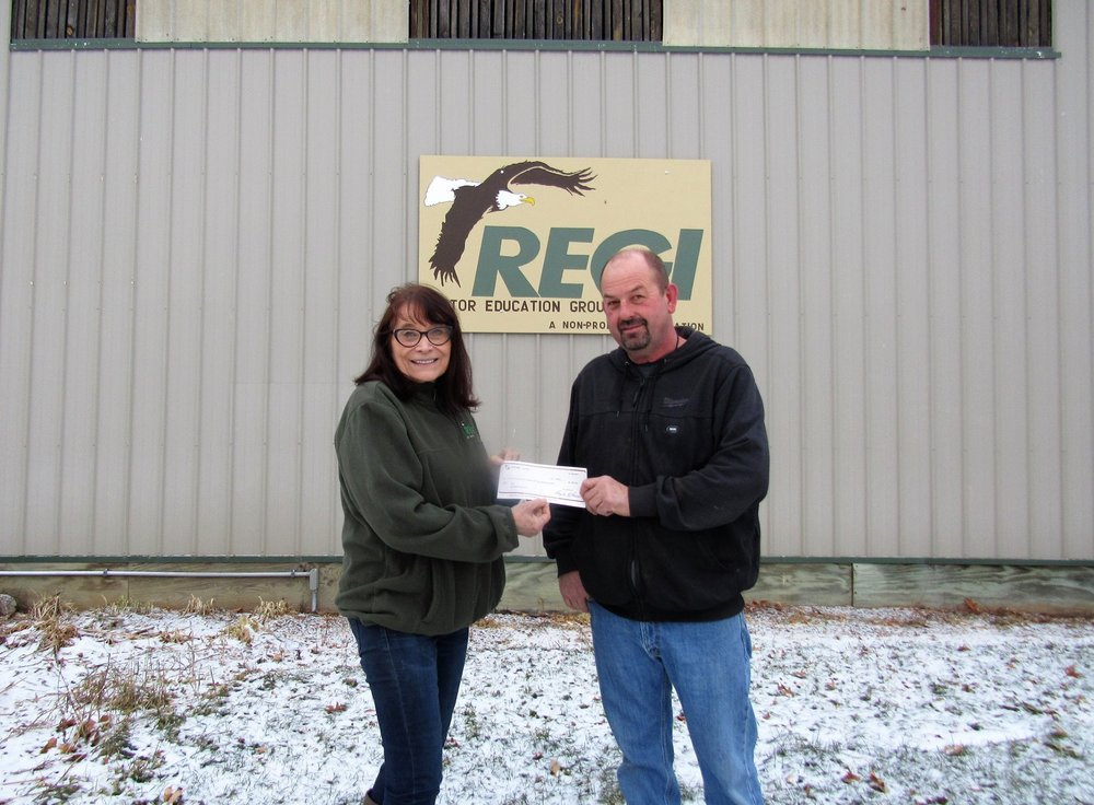 John Sowinski - Creepy Hollow/Haunted Trail Walk presents check to Marge Gibson