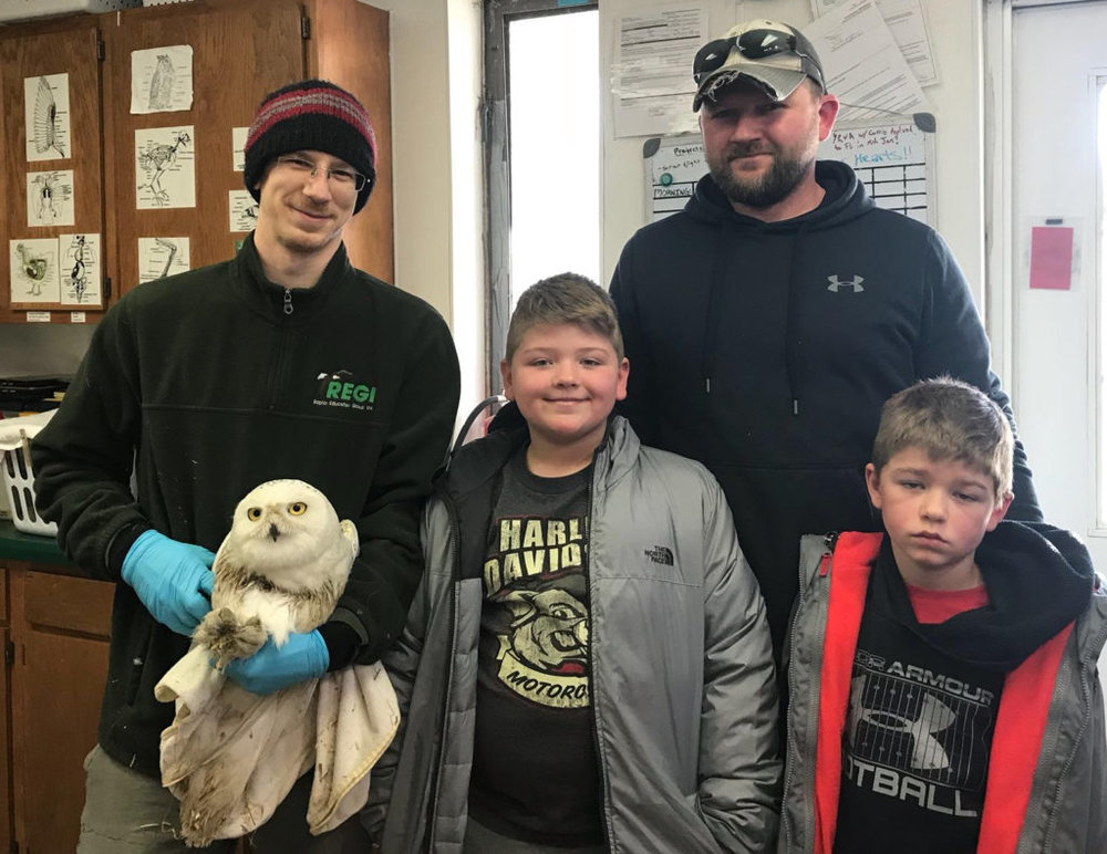REGI BIOLOGIST GREG RUSS HOLDS CODDINGTON SHORTLY AFTER BRIAN BIADASZ AND HIS SONS, KOLTON AND JAKE, RESCUED THE OWL FROM THEIR BARN. (©RAPTOR EDUCATION GROUP)