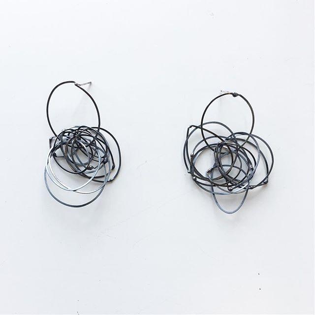 These fun loopy scribble post earrings ➰➰ are in gallery 311 at #torpedofactoryartcenter. Made in a loosy goosy melty way. Blackened silver. #torpedofactoryartist #megbyhand