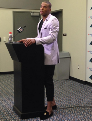 Cam Netwon wearing Capris during press conference