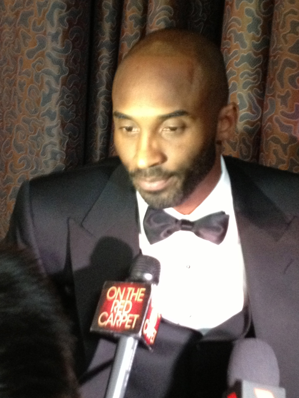 Here is a close up of Kobe Bryant interviewing with our on the  Red Carpet  reporter Tony Cabrera.
