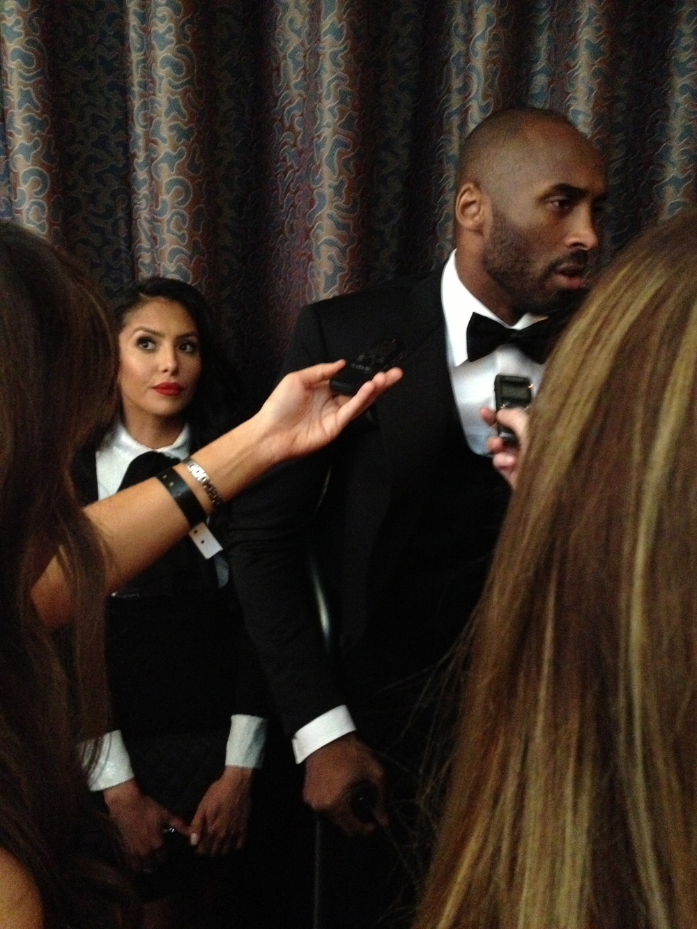 Vanessa Bryant standing by Kobe's side