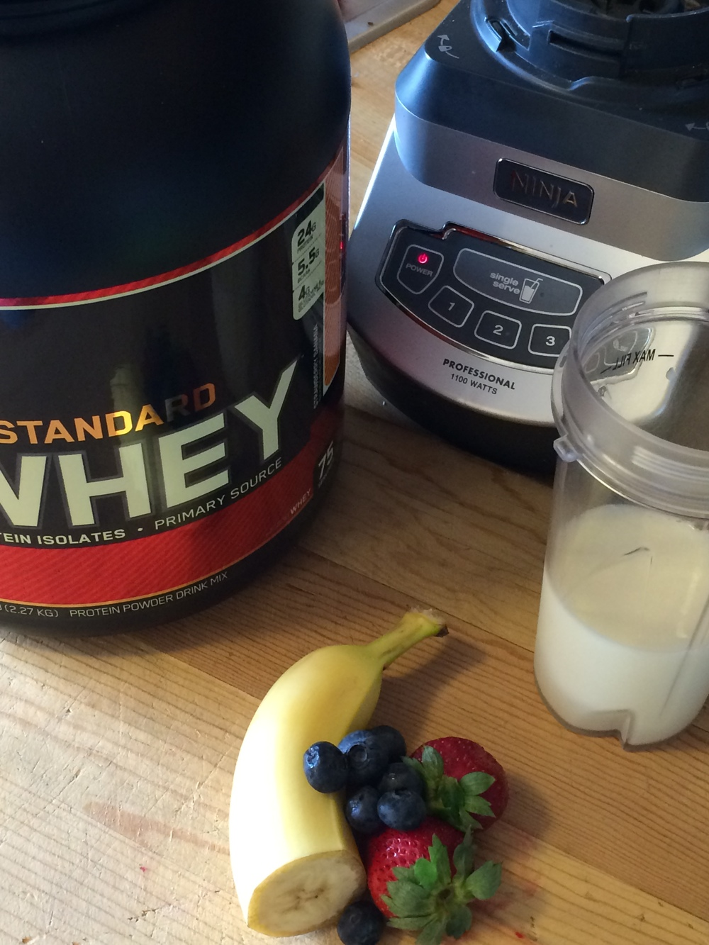 Protein Powder, Banana, Strawberries, Blueberries, Milk, Ice (optional).