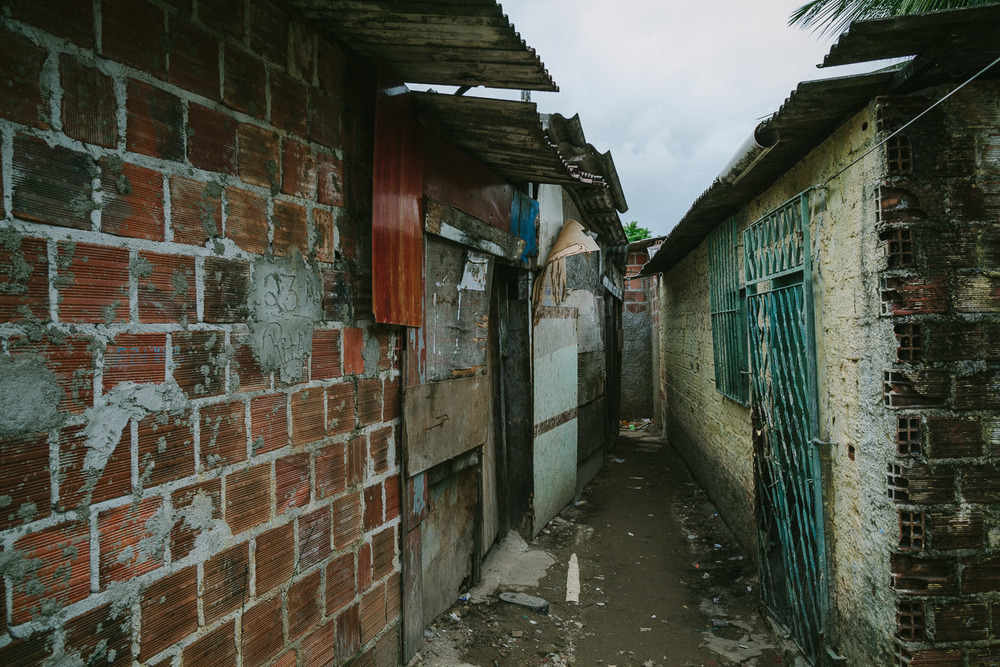 The neighborhood where Emidio lives is a very very poor section of the city with substantial poverty and high crime rate. Many of the houses are nothing more than pieces of thin wood and tin. In spite of this, many friendly people live there and are often generous with their smiles and kindness.