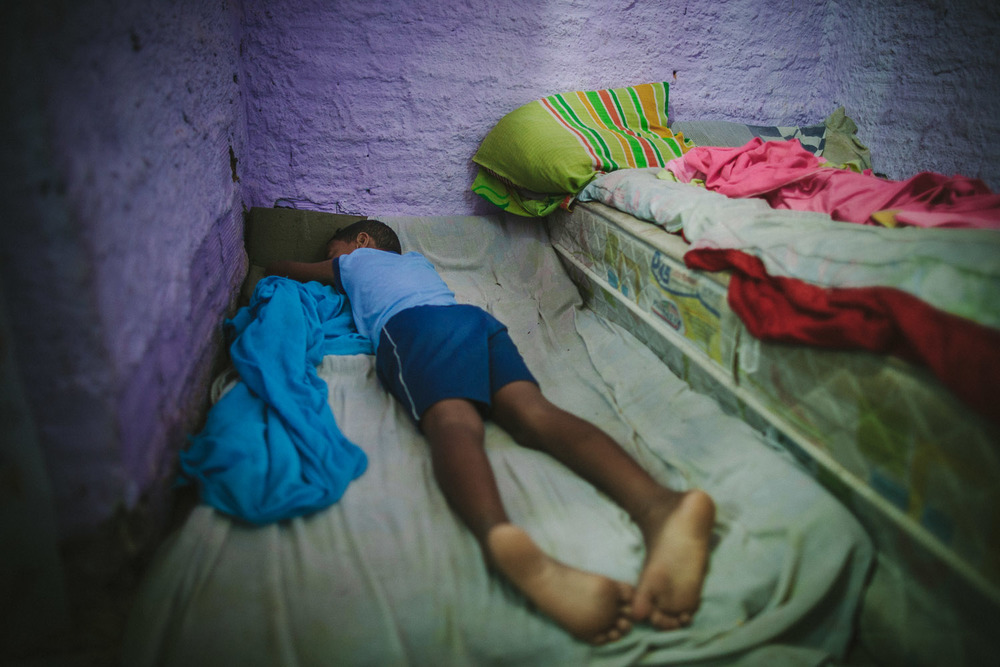 Emidio starts his day waking up from a very thin mattress on the floor. Emidio's entire house (housing 4 people---soon to be 5) is perhaps no larger than 8 feet by 10 feet. This is Emidio's morning routine before heading to classes at the Compassion Center.