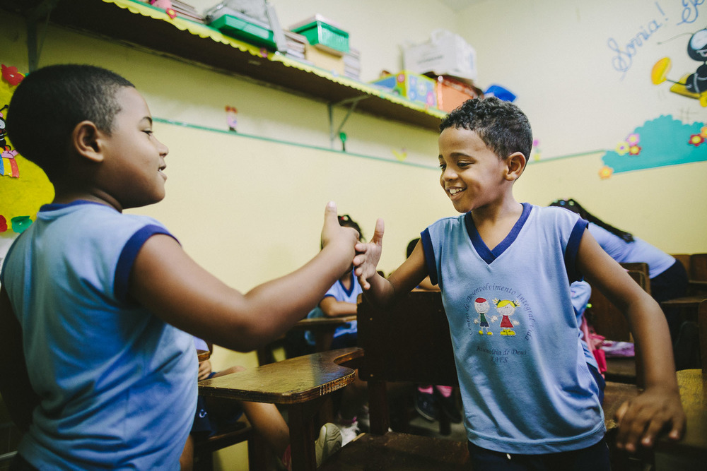 Emidio and his class buddy have several special handshakes that only they do together. Emidio during classes at the Compassion Center.