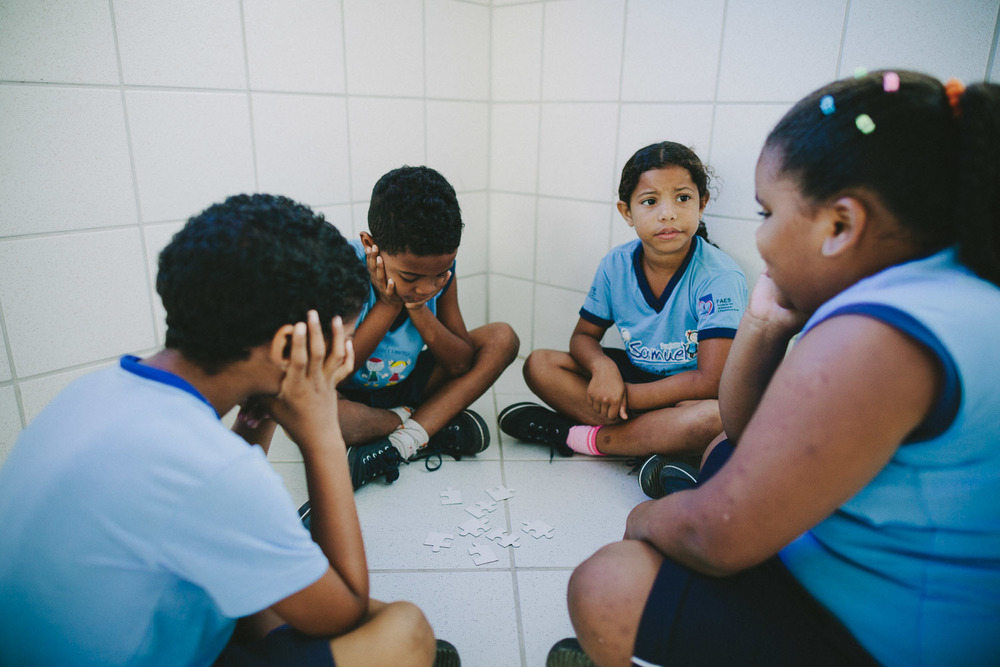 Emidio and his friends prepare to compete against their classmates during a puzzle challange. Emidio during classes at the Compassion Center.
