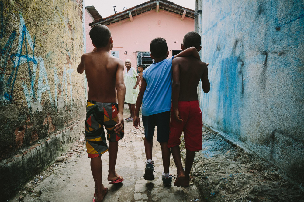 "Emidio is join by a friend on his walk back from the Compassion Center. After his time at the Compassion Center, Emidio walks to his ""aunt's"" house (family friend---no relation) to be taken care of before heading to school since his mother works until 10pm each night."