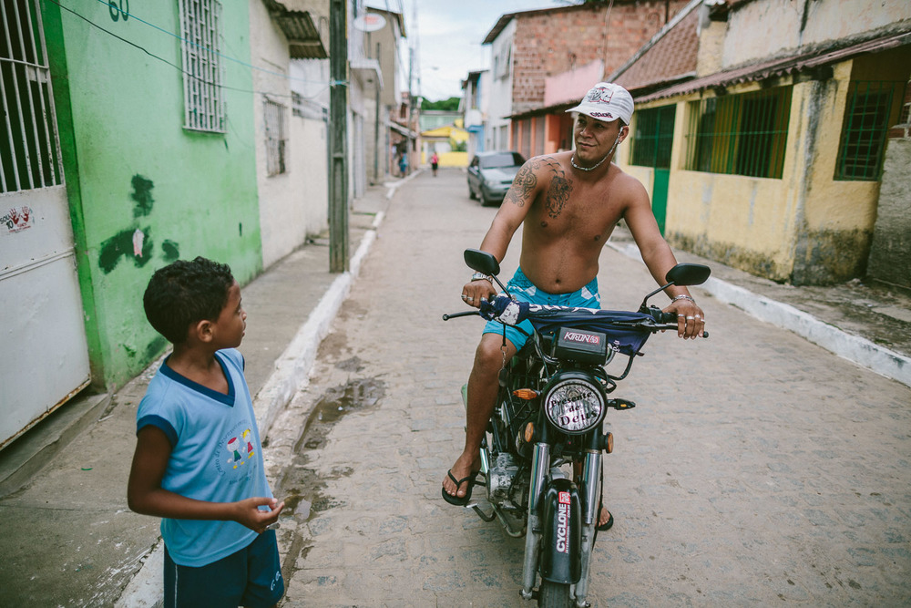 "On the way home, Emidio runs into another family friend whom he calls uncle. After his time at the Compassion Center, Emidio walks to his ""aunt's"" house (family friend---no relation) to be taken care of before heading to school since his mother works until 10pm each night."