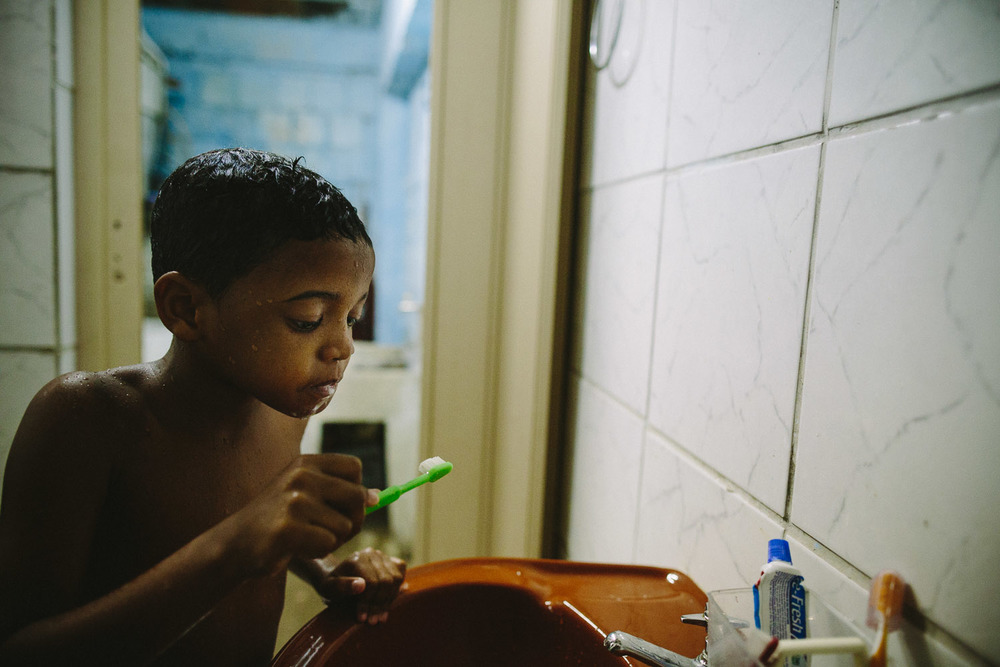 "Hygiene is very important to Emidio evidenced by his second teeth bushing of the day. Each day an ""aunt"" (family friend--relation) takes care of Emidio and his younger brother between his time at the Compassion Center and School since his mother works until 10pm at night."