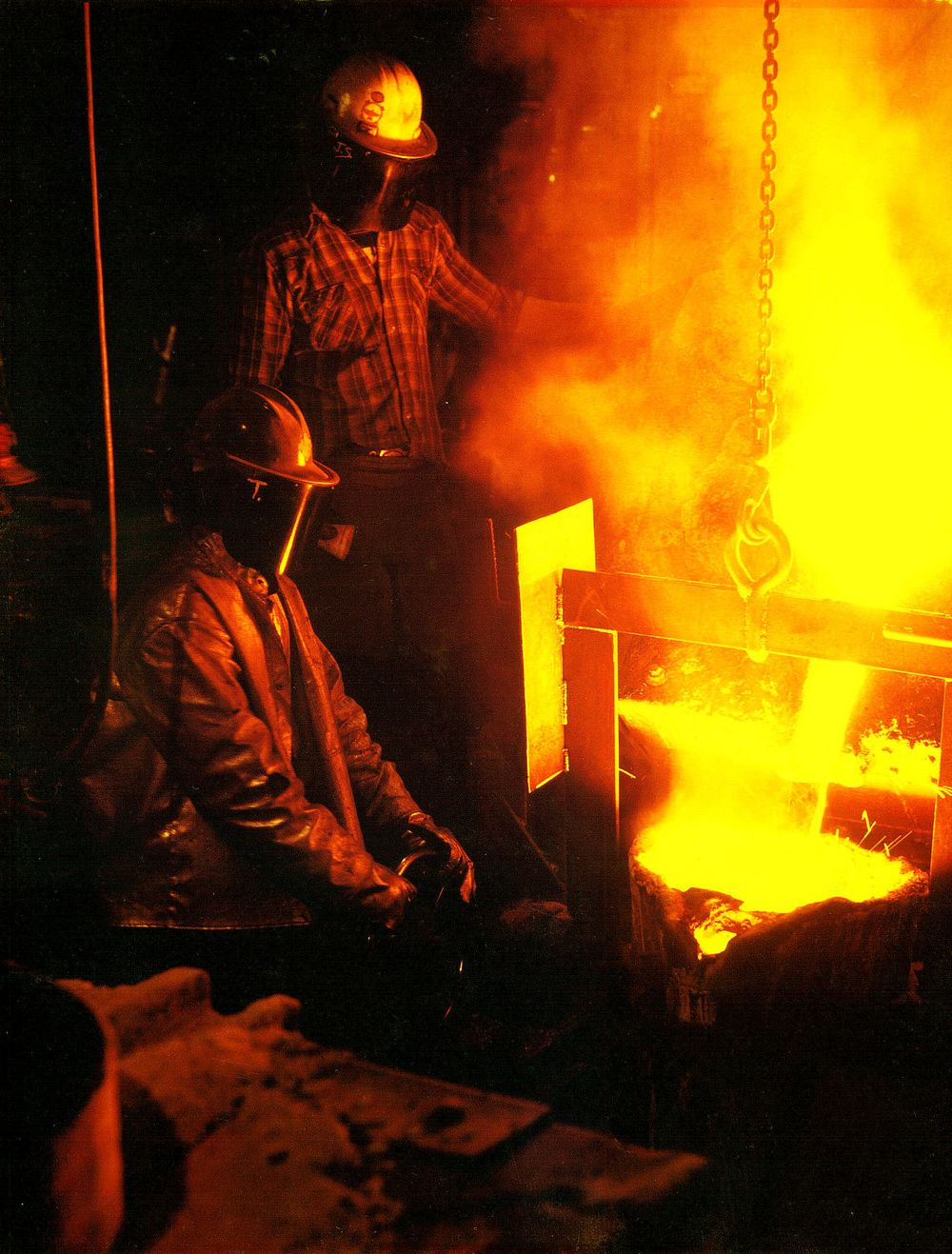 My Dad on the floor of the foundry circa 1981 pouring liquid metal into a casting