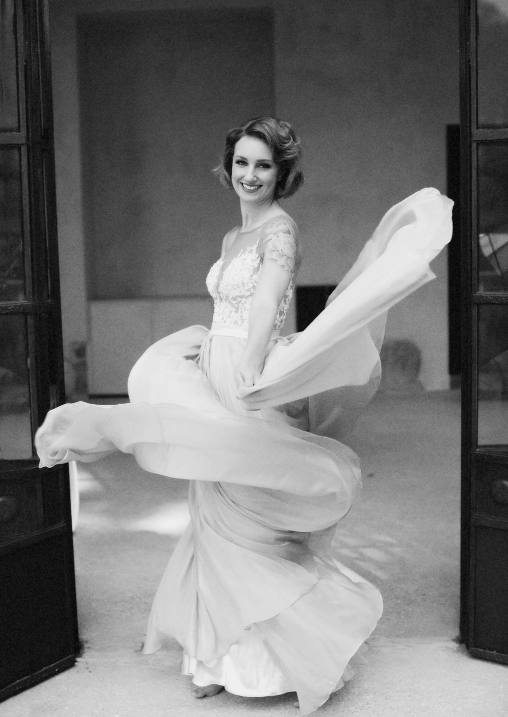 Portrait of lady dancing in dress swirling around her body