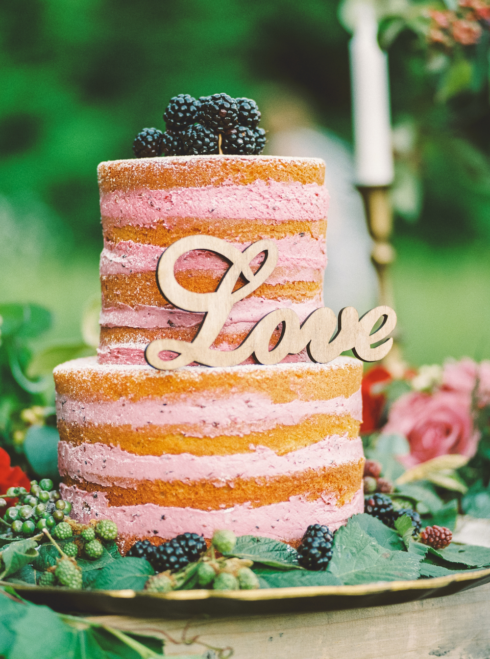 bare wedding cake with fruit