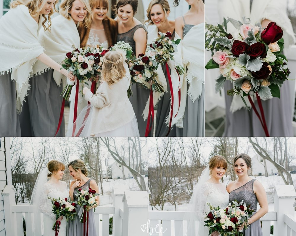 Bridesmaids wearing grey dresses in winter