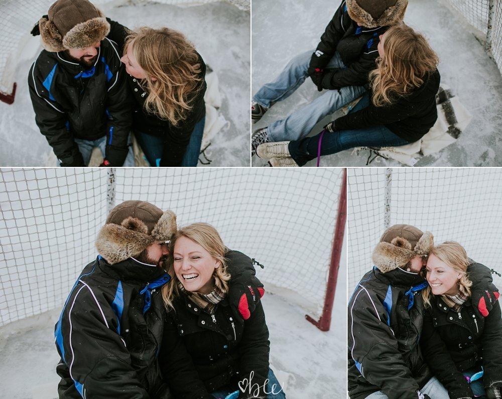 couple cuddling outside in winter on a skating pond