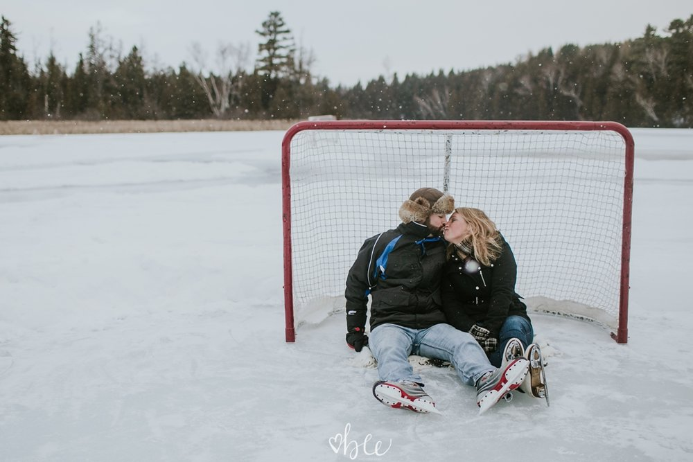 couple sitting under a hockey net on Palgrave Pond