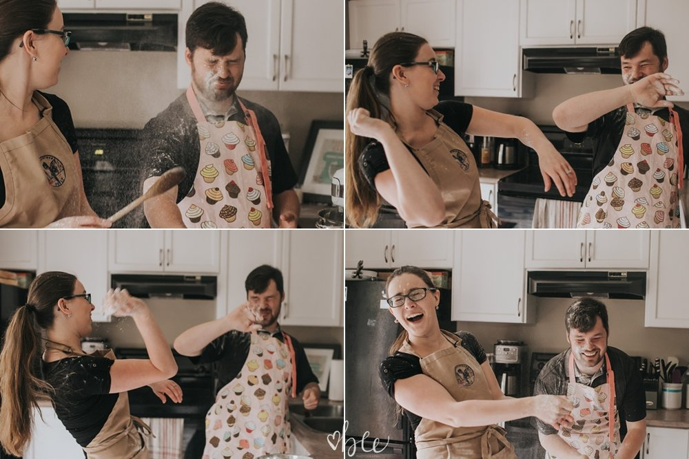 Engaged couple throws flour at each other while baking