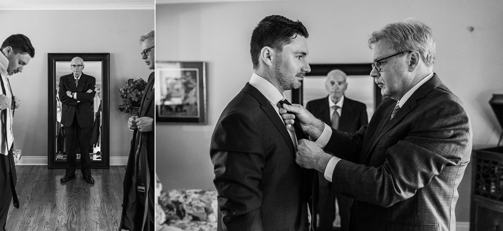 dad tieing his son's tie for a wedding