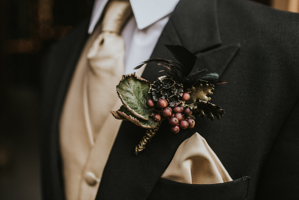 Unique boutonniere made by Darlene of Season's Floral for a Halloween inspired Styled Shoot