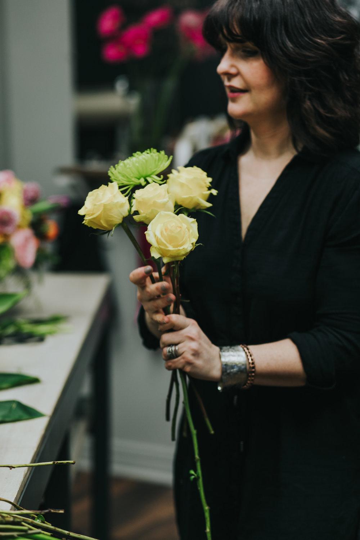 Darlene of Season's Floral hard at work in her studio in Schomburg
