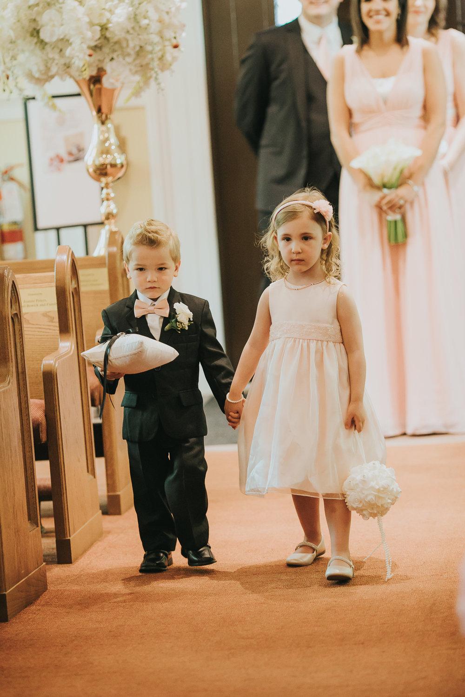flower-girl-and-ring-boy-walking-down-aisle-italian-wedding