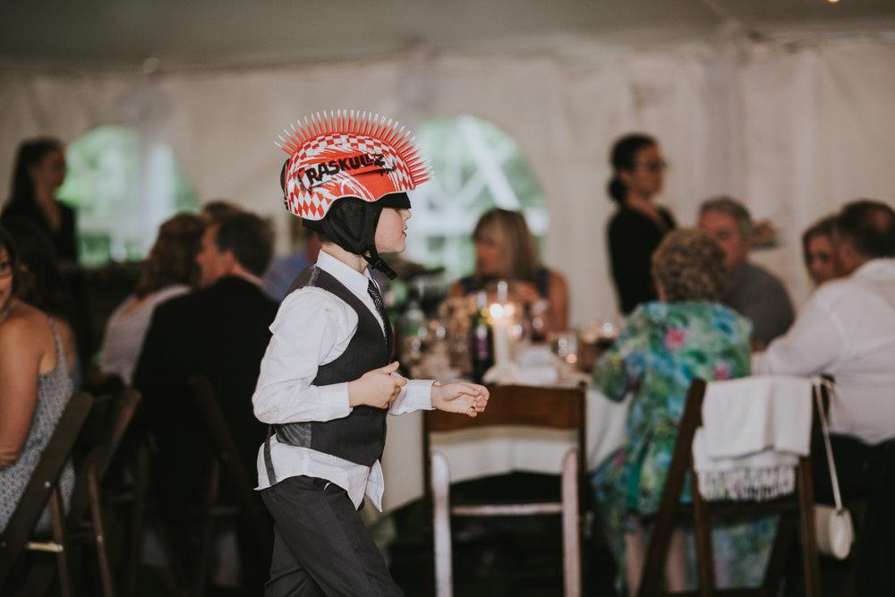 kid-at-wedding-wearing-mohawk-helmet-dancing