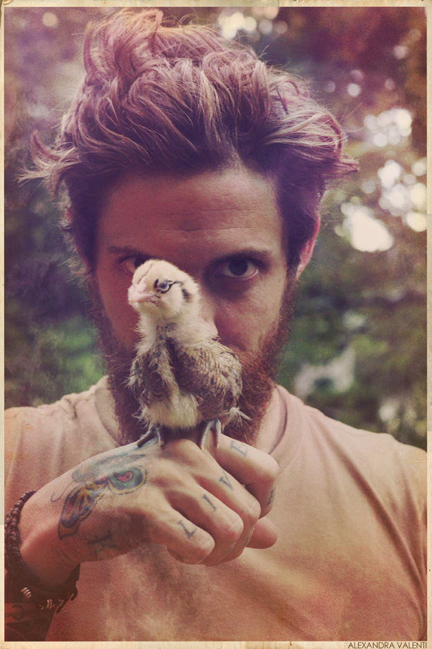 my man and one of our new baby chickens.
