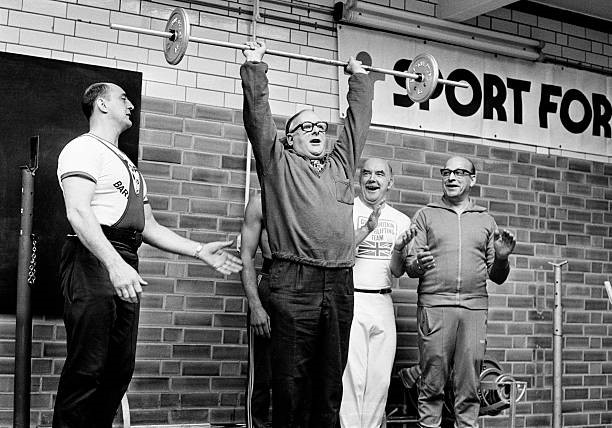 Denis Howell, Minister for Sport, lifting weights after opening a new sports and leisure centre in Birmingham, 26th Sept 1977