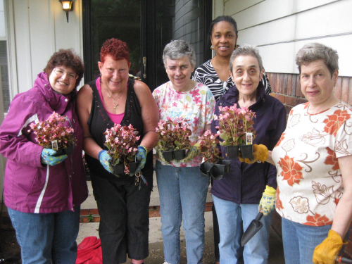 Planting flowers at the Samuels Home for JARC's annual Flower-a-Thon event.